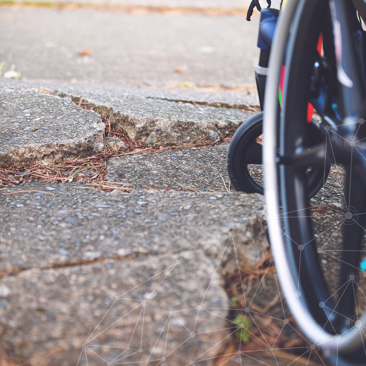 Sidewalk or pedestrian ramp that doesn't meet ADA compliance due to cracking.
