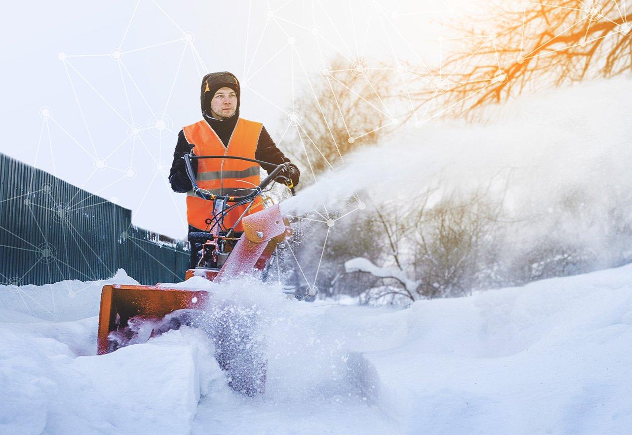 Steets department worker, sidewalk snow removal, snow blower